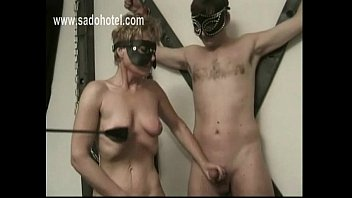 Horny slave mastrubate her own pussy and jerking off an other slave while she got spanked on her but