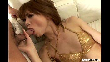 japanese cuttie in her golden bathing suit fellating.