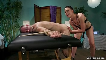 Dominant masseuse spanks and fucks client
