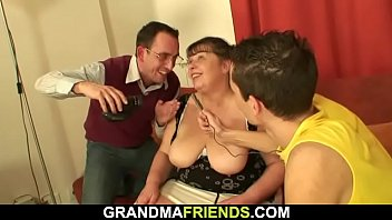 Big tits granny swallows two young cocks