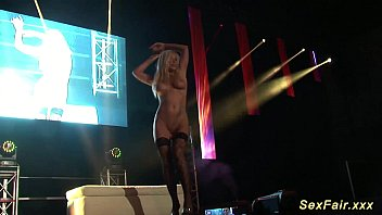 german monstrous-titted cougar on public stage