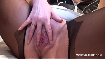Erotic mature babe in stockings masturbating with vibrator